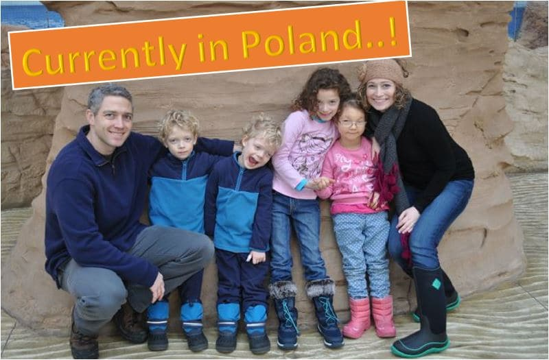 Adoptive family in Poland with their daughter.