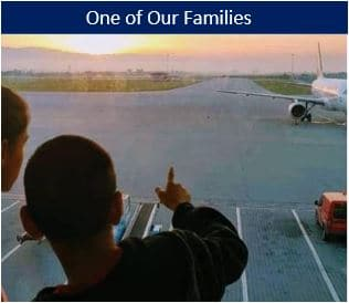 Kids pointing to an airplane after leaving the orphanage.