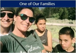 Adoptive family comes together after having met all requirements.