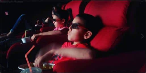 adopted siblings watching a movie in Bulgaria.