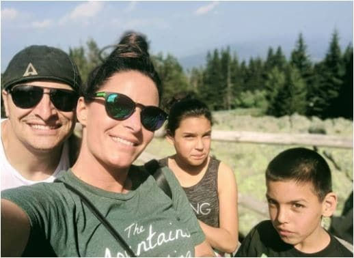 adoptive family going hiking together.
