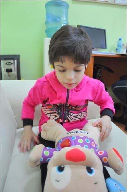 Bulgarian child playing with toys in the orphanage.