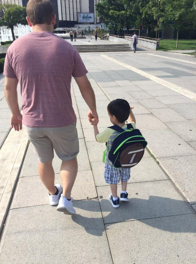 Adoptive father taking a walk with his 3 Year Old Son in Sofia.