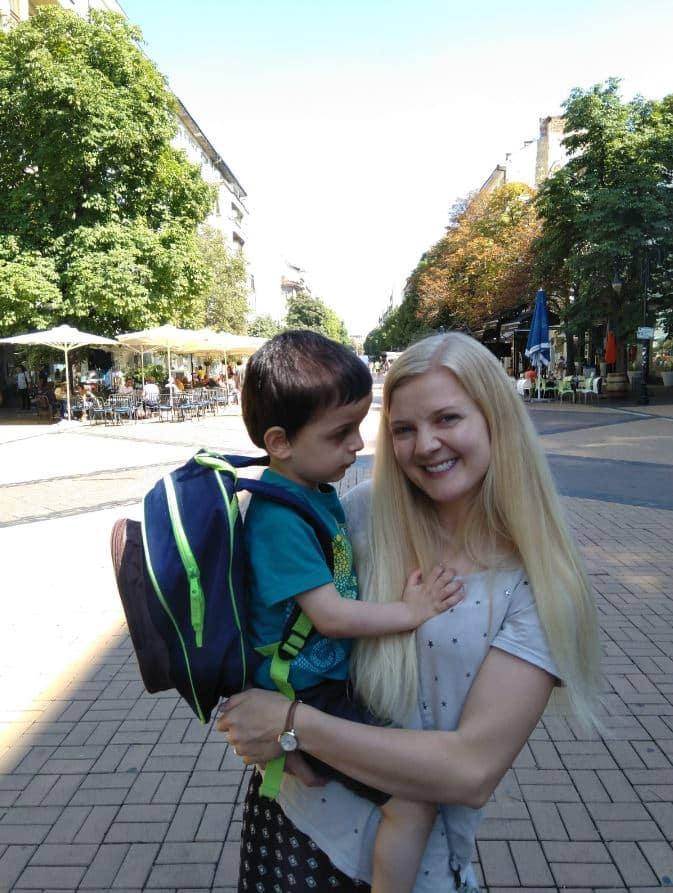 Adoptive Mom holding her son.