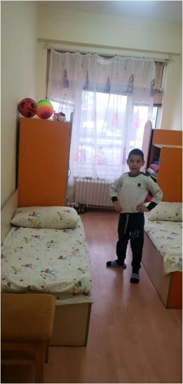 Bulgarian child being adopted from the orphanage. .